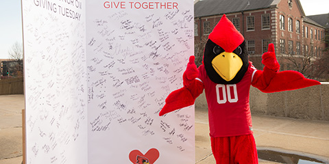 Reggie Redbird in front of a giant Thank You card