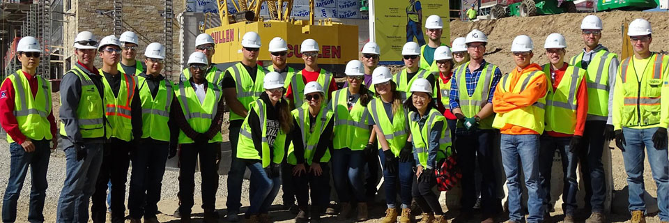 Students gather at a live construction site.